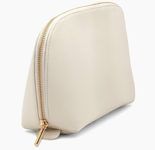 white leather travel case with gold zipper